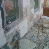 Front porch getting rock installed